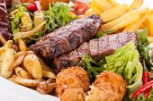 foto of endive  - Wholesome platter of mixed meats including grilled steak - JPG