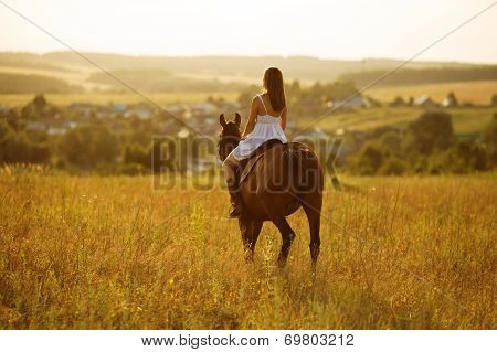 Girl In Dress Sitting On A Horse