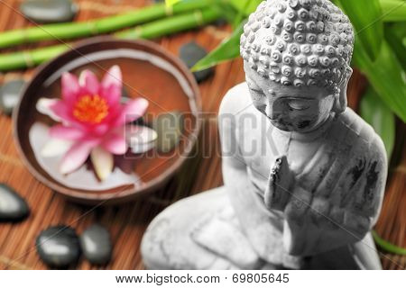 Spa and wellness setting with buddha and flowers,Shallow Dof.