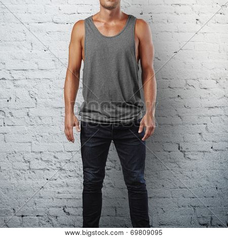 Man wearing sleeveless shirt