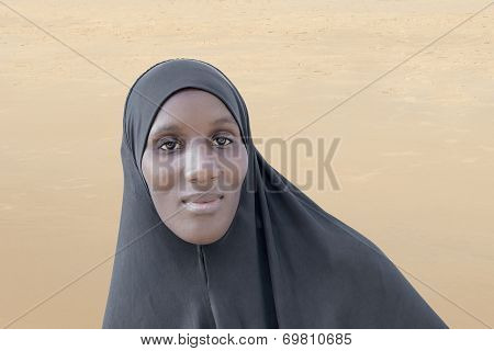 African woman wearing a black cotton veil in the desert