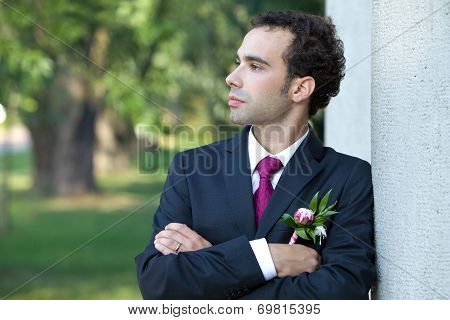 Portrait of the groom with a buttonhole of the peony flower.