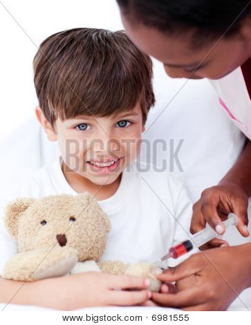 Caring Female Doctor Playing With A Little Boy