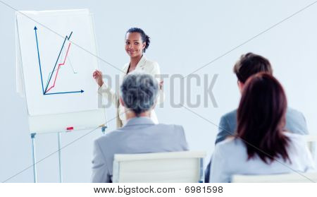 Smiling Ethnic Businesswoman Doing A Presentation