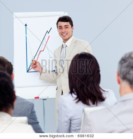 Positive Young Businessman Doing A Presentation