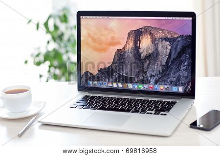 Macbook Pro Retina With Os X Yosemite Is On The Table In The Office