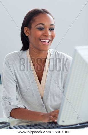 Radiant Businesswoman Working At A Computer