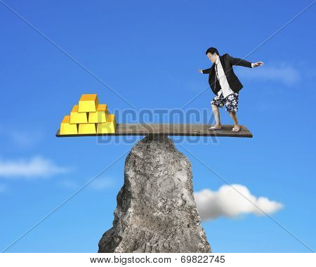 Person Stands On Rocky Seesaw Vs Stack Of Gold