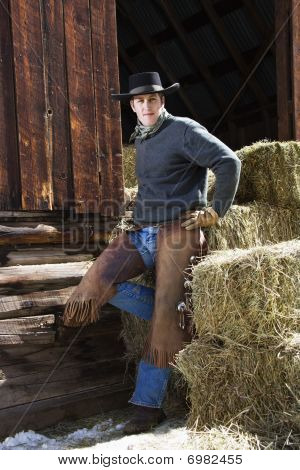 Attractive Young Man Leaning On Hay Bales