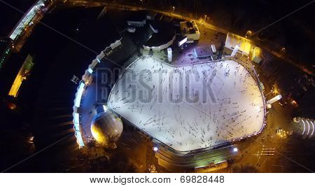 MOSCOW, RUSSIA - NOVEMBER 23, 2013: Many people are skating at the rink in Sokolniki Park in the evening, aerial view. Rink in Sokolniki one of the biggest in Moscow