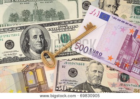 Apartment key. Golden key on money background. Banknote.