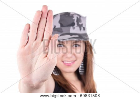 Beautiful young girl wearing a military cap
