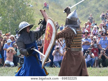 two warriors fighting historical reenactment festival of historical reconstruction in Samara, Russia