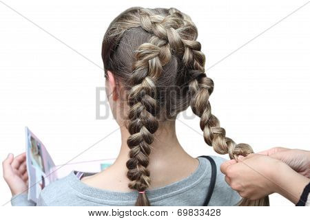 Hairdresser making a braid for a girl. Children's hairstyle. Braids.