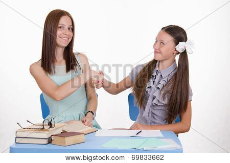 Teacher And Student Shake Hands With Each Other