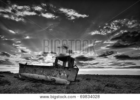 Abandoned Fishing Boat On Beach Black And White Landscape At Sunset