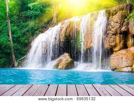 Waterfall With Wood Bridge