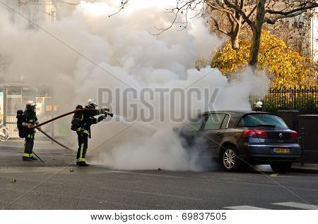 Firemen Extinguishing Fire from the Car