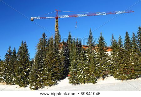 Crane on a mountain resort construction site