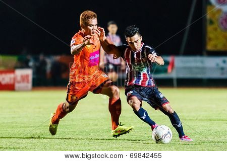Sisaket Thailand-august 3: Chanathip Songkrasin Of Bec Tero Sasana Fc. (blue) In Action During Thai