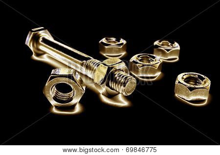 Golden Screws And Bolts Isolated On Black