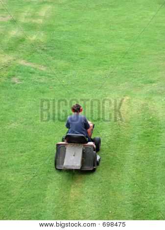 Man Riding Lawnmower