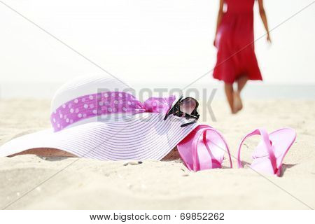 Girl With Flip-flops On The Beach
