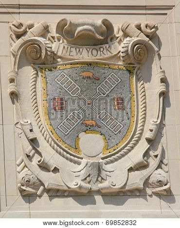 Mosaic shield of renowned port city New York at the facade of United States Lines