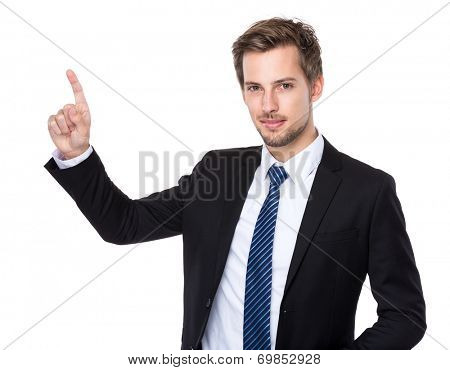 Caucasian businessman with finger touch imagery panel