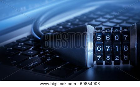 Lock on computer keyboard - data security concept image