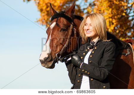 beautiful woman walking with horse