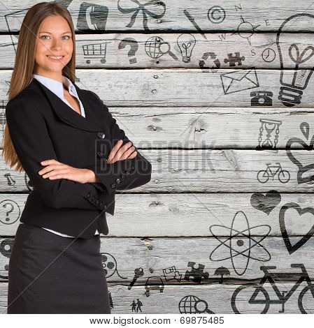 Businesswoman with background of various icons