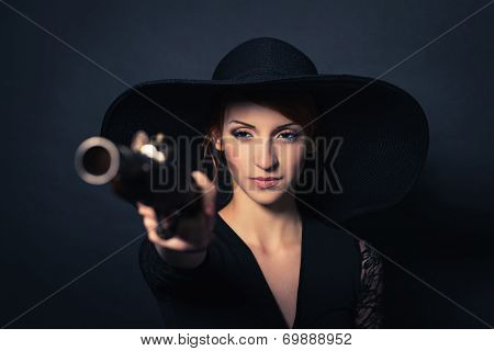 girl pirate with ancient pistol
