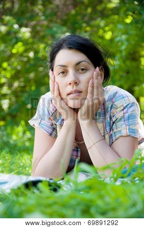 Beautiful Middle-aged Woman Lying On Grass