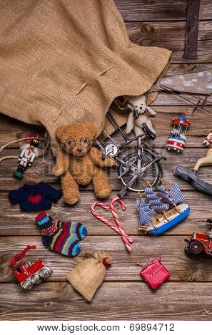 Presents And Gifts Of Santa's Sac: Old Wooden Antique Toys For Children.