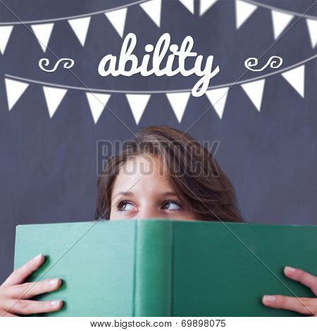 The word ability and bunting against student holding book