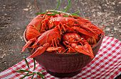 picture of crawfish  - Bowl of fresh boiled crawfish on the old wooden background - JPG
