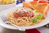 stock photo of caesar salad  - Homemade spaghetti with meat sauce garlic bread and caesar salad - JPG