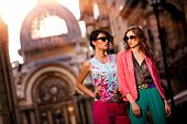 stock photo of woman red blouse  - Fashion shot of two elegant beautiful girls in the sunset wearing sunglasses - JPG