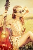 stock photo of hippies  - Romantic girl travelling with her guitar - JPG