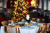 stock photo of christmas meal  - Beautiful table setting for Christmas party or New Year celebration in restaurant - JPG