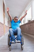 pic of pupils  - Cute disabled pupil smiling at camera in hall at the elementary school - JPG