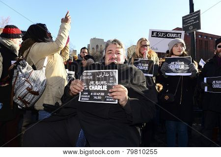 Disabled man with Je Suis Charlie sign