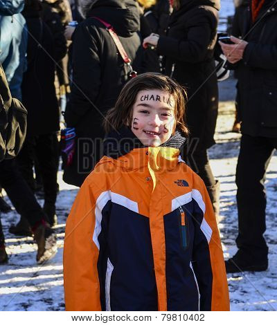 Little girl with face writing