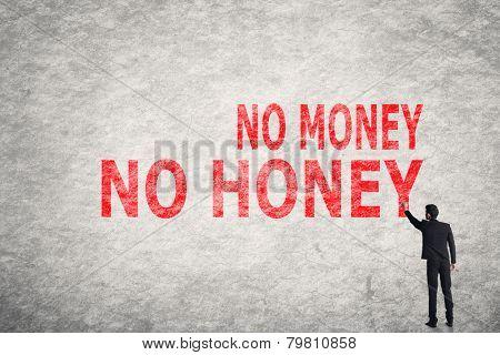 Asian businessman write text on wall, No Money No Honey