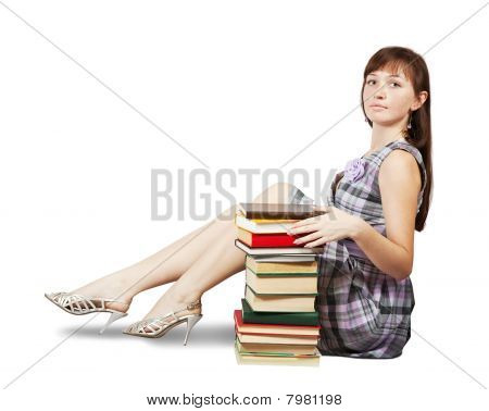 Student Sitting With Pile Of Books