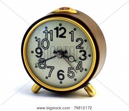Old brown alarm clock, isolated on white