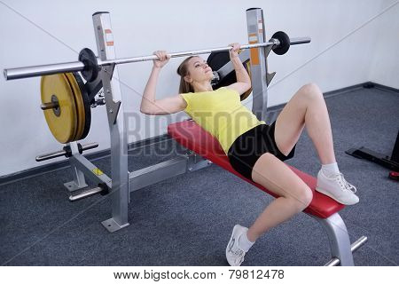 young girl deals with a barbell