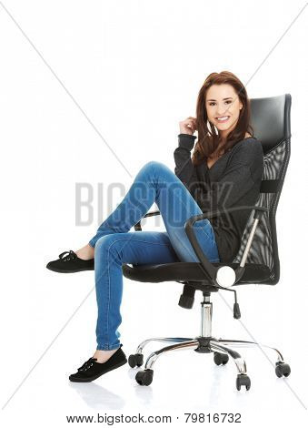 Young happy student woman or businesswoman sitting on a wheel chair.
