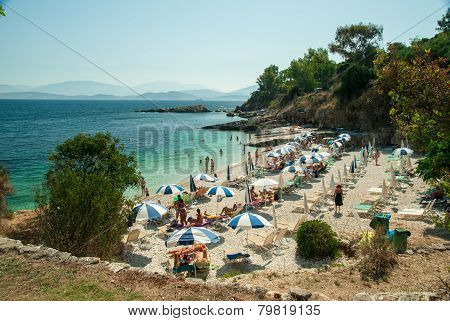 Kassiopi Beach, Corfu Island, Greece. Sunbeds And Umbrellas